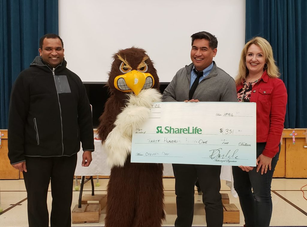 Cheque presentation at St. Henry TCDSB