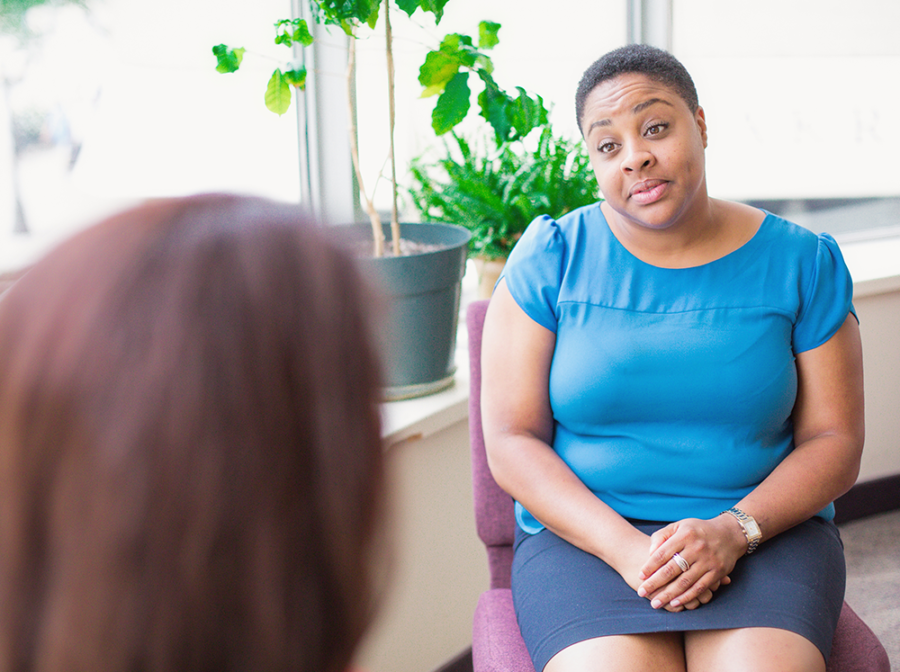 A counsellor listens to a client at CFS Toronto