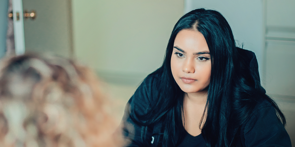 A young woman receives counselling at Rosalie Hall